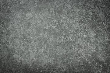 Rough grey stone tile background.