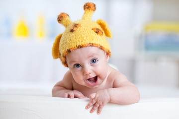 baby child in costume of giraffe