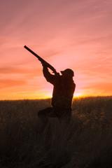 Printed kitchen splashbacks Hunting Hunter Shooting at Sunrise