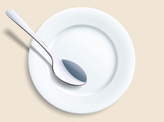 Empty plate with a spoon