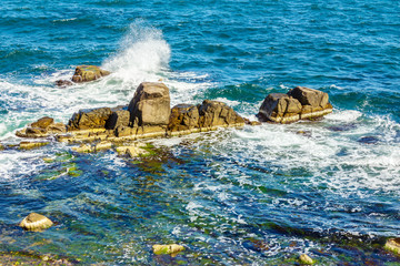 sea waves breaks about rocky shore