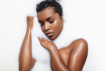 black woman in a milk bath