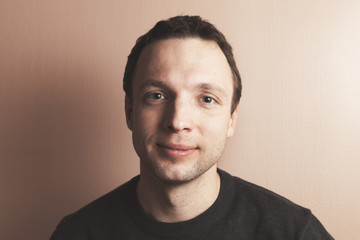 Young handsome positive Caucasian man portrait