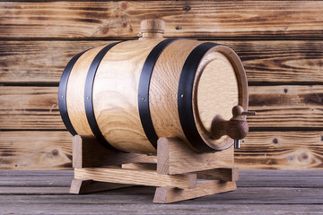 Wooden barrel on a wooden background