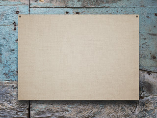 Close-up of one nailed blank poster canvas frame on blue and grey weathered wooden background