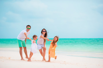 Happy young family on beach vacation