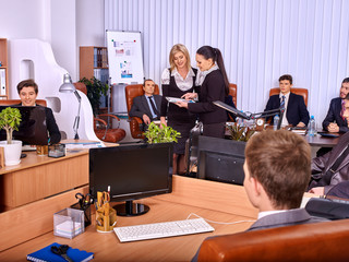Happy group business people in office. Two business women are consulted.