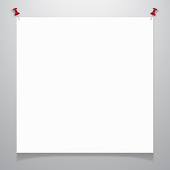 White sheet of paper pinned to the wall.