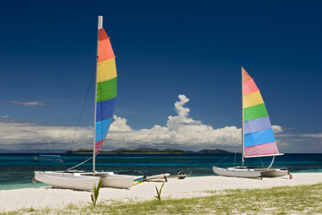 Catamarans on sandy beach. Fiji, South pacific.
