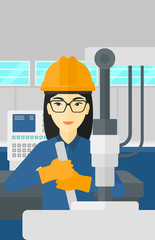 Woman working with industrial equipment.