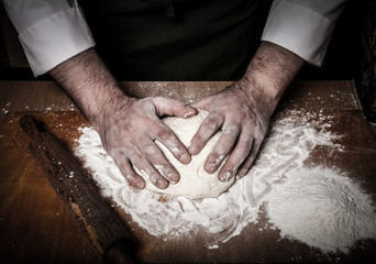 The process of making home bread by male hands. Toned