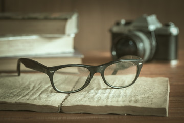Artwork in retro style, old-fashioned camera and stylish glasses