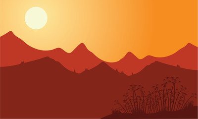 Silhouette of mountain with red background