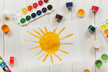Drawing sun on the desktop, a top view. Education and art, creat