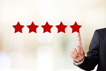 Businessman hand pointing five star