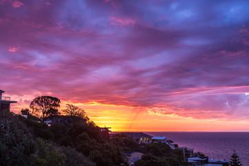Houses on Olivers Hill overlooking the Mornington Peninsula at wild sunset, Australia