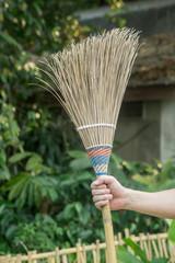 Broom in hand
