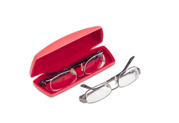 Two modern pairs of eyeglasses and red glasses case