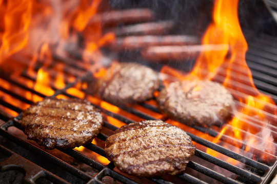 grilling hamburgers and hot dogs