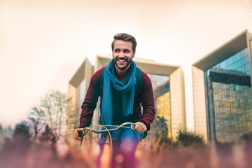 Handsome man riding a bike