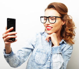 Smiling cheerful blond-haired woman doing selfie