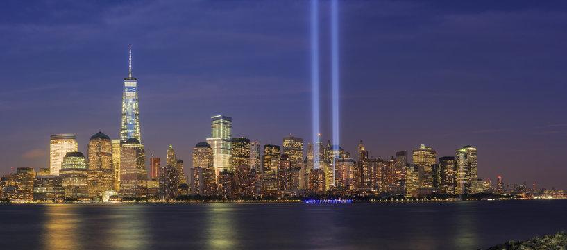 911 Memorial light and New York City skyline
