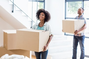 Young couple moving together in a new house