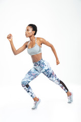 Concentrated beautiful young african american sportswoman running