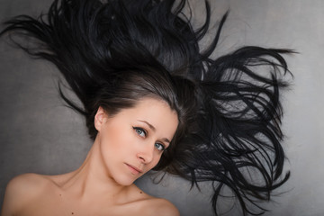 Beautiful black hair. Top view of women with beautiful hair on dark background.