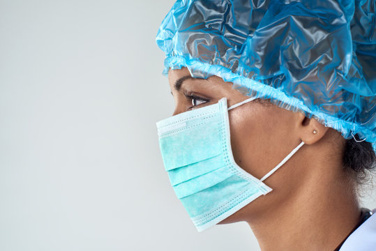 Side profile of confident female surgeon in mask