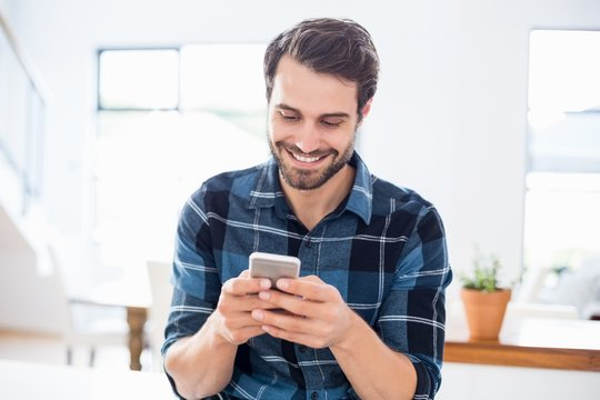 Happy man using mobile phone