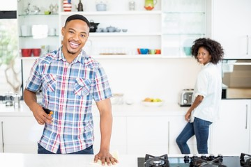 Portrait of young couple standing in kitchen