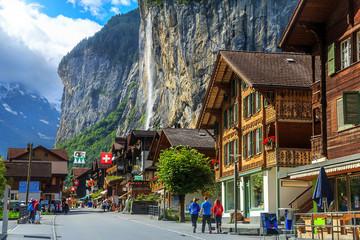 Famous Lauterbrunnen town and Staubbach waterfall,Bernese Oberland,Switzerland,Europe Wall mural