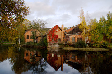 Old red brick buildings by Akerselva river in Oslo, Norway.