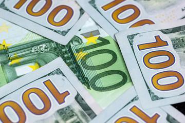 100 dollar and 100 euro banknotes