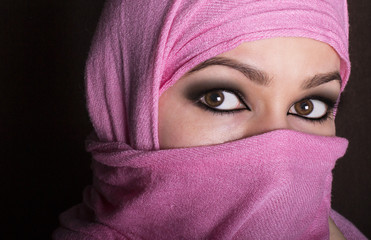 close-up beautiful mysterious eyes eastern woman wearing a hijab