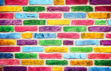 Bunte farbige Ziegelsteine..Farbenfrohe Mauer..Geeignet als Hintergrund oder Textur