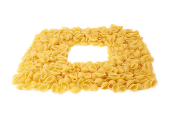 Square frame made of dry conchiglie pasta over isolated white background