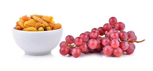 raisin in the white bowl and grape on white background