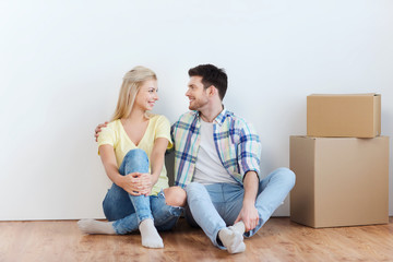 couple with cardboard boxes moving to new home