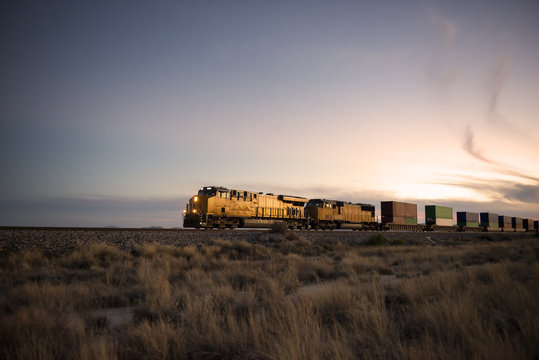 Cargo train traveling through desert