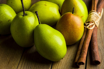 Fresh pears on a rustic wooden background