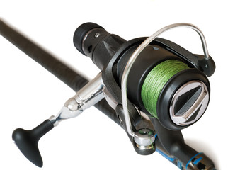 Feeder - fishing tackle for catching fish on a white background.
