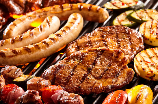 Various meats and vegetables on hot grill