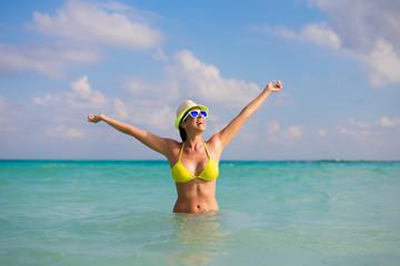 Joyful woman having fun on summer caribbean vacation in the sea.