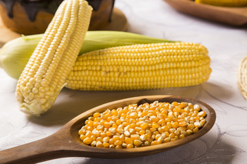 close view on Homemade golden corn cob with butter and salt on t