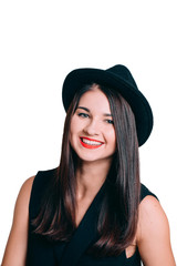 Portrait of smiling young woman in a hat