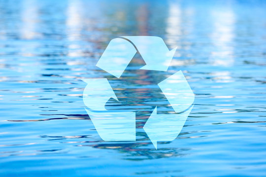 Recycling symbol on water background