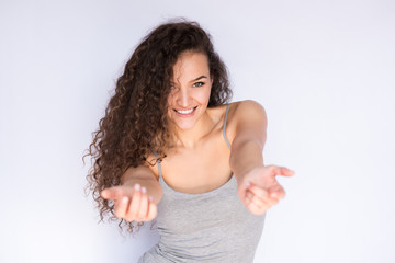 Beautiful smiling young woman with arms outstretched.Come on!