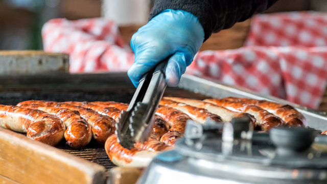 Sausages Cooking On Grill. Street Food Market Vendor